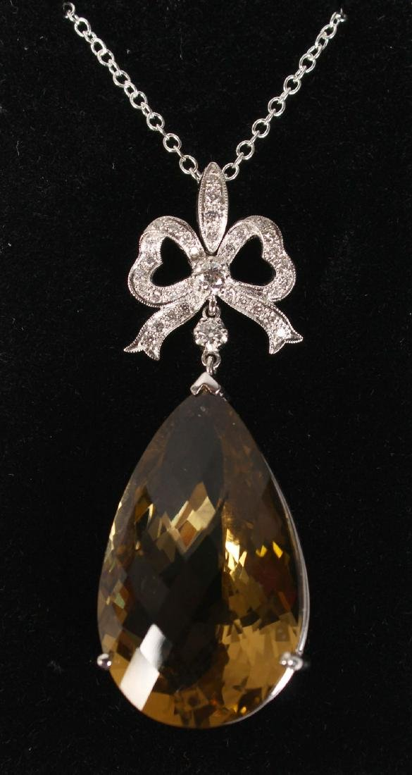 AN 18CT WHITE GOLD SUBSTANTIAL CITRINE AND DIAMOND