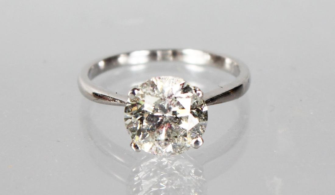 A SUBSTANTIAL 18CT WHITE GOLD SINGLE STONE DIAMOND RING