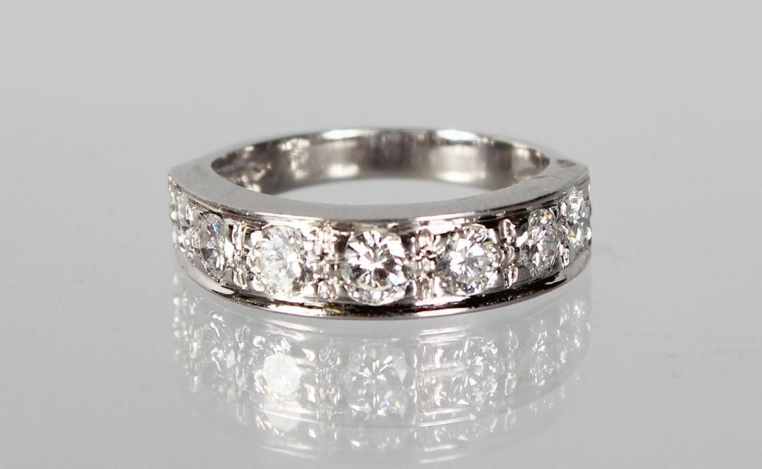 AN 18CT SEVEN STONE DIAMOND HALF ETERNITY RING OF 1.3