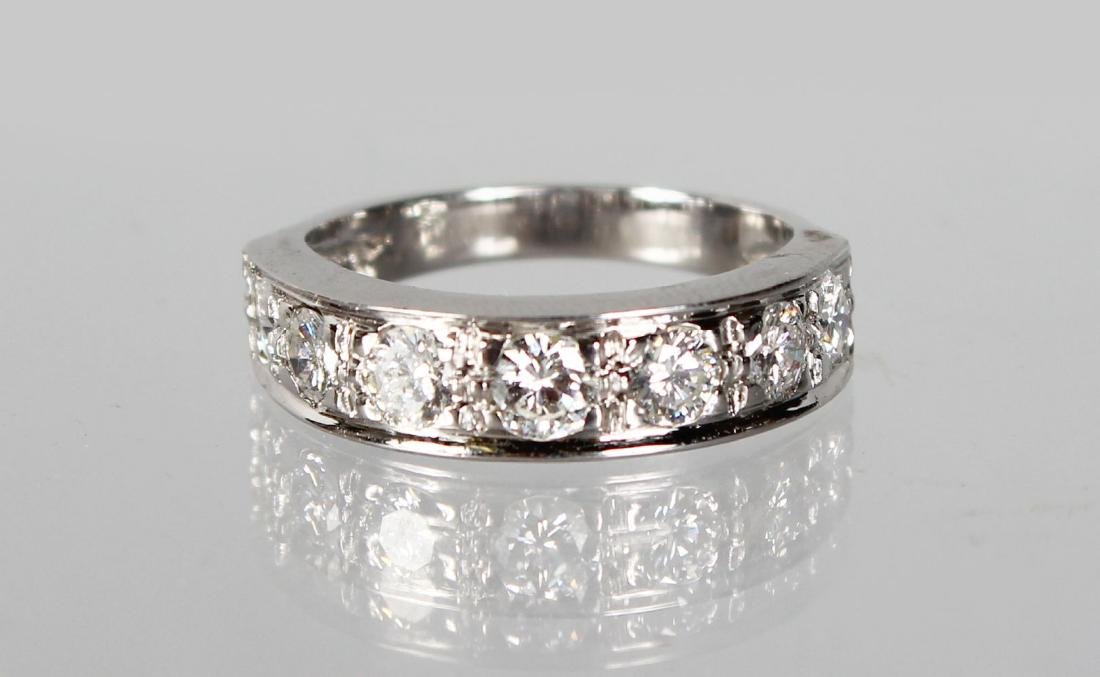 AN 18CT SEVEN STONE DIAMOND HALF ETERNITY RING OF 1.3