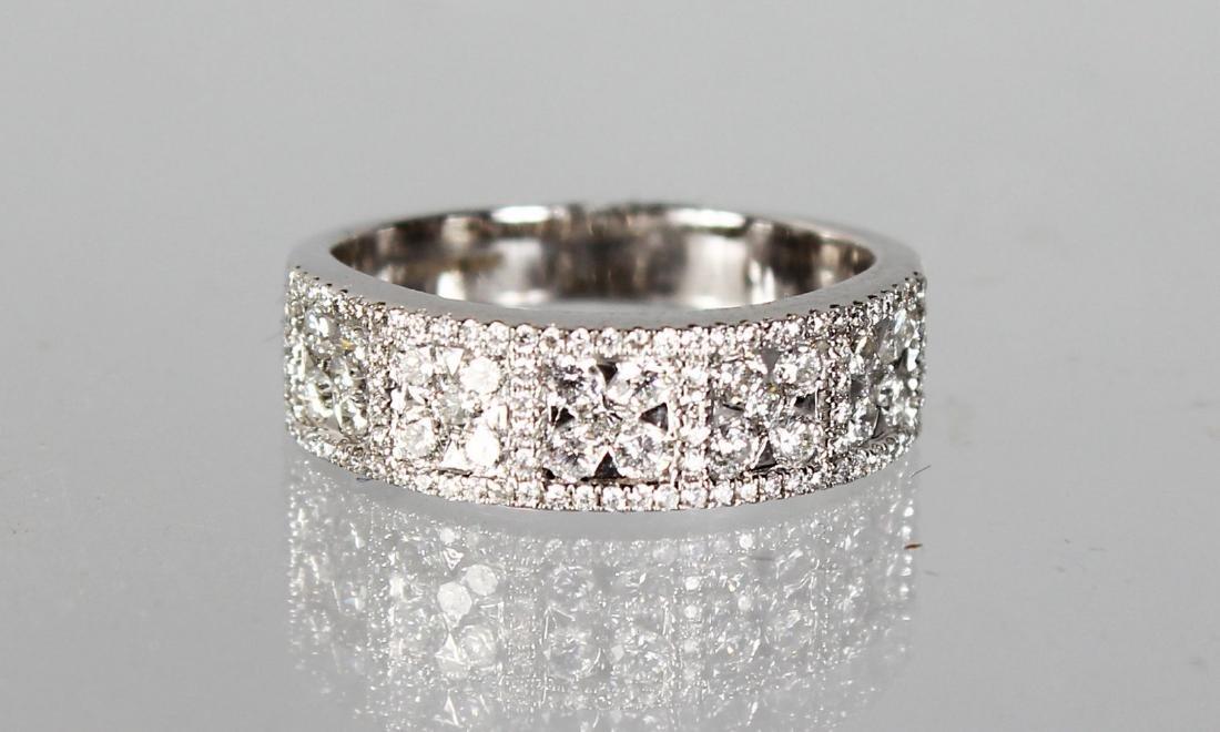 AN 18CT WHITE GOLD DIAMOND PANELLED HALF ETERNITY RING