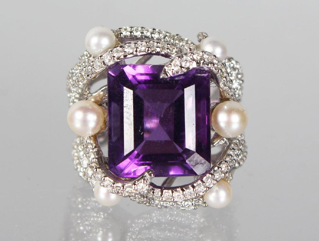 AN 18CT WHITE GOLD RING WITH SUBSTANTIAL AMETHYST AND