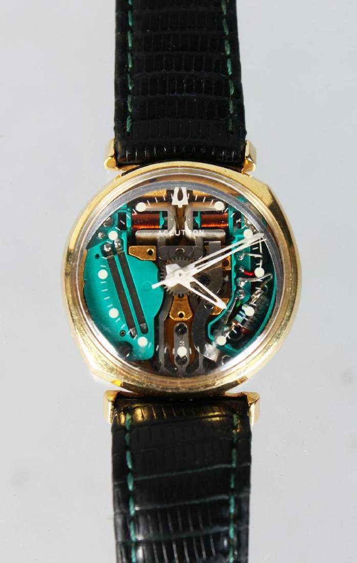 A 14CT YELLOW GOLD BULOVA ACCUTRON WATCH ON LEATHER