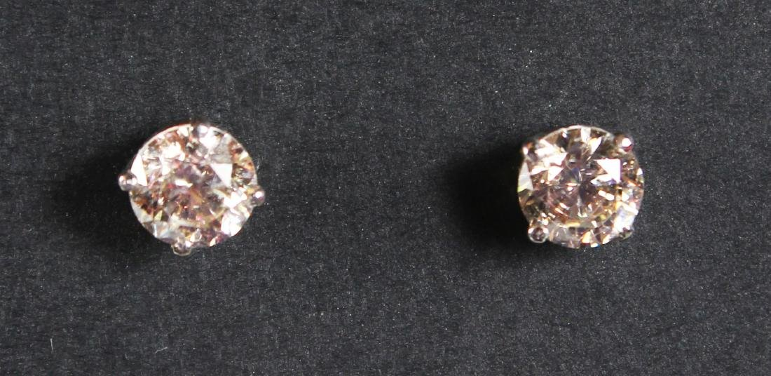 A PAIR OF WHITE GOLD DIAMOND STUD EARRINGS ON 2.1 CT'S,