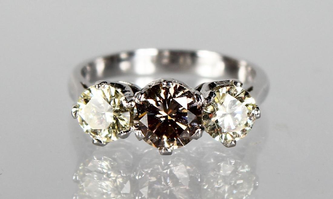 AN 18CT WHITE GOLD THREE STONE FANCY CULTURED DIAMOND