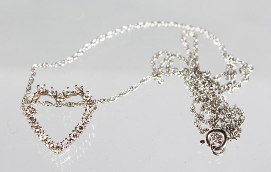 A WHITE GOLD DIAMOND HEART SHAPED PENDANT AND CHAIN.