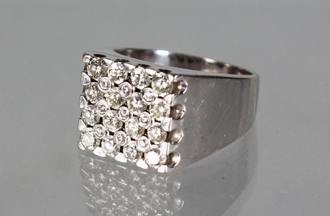 A VERY GOOD 18CT WHITE GOLD DIAMOND SET SQUARE RING.