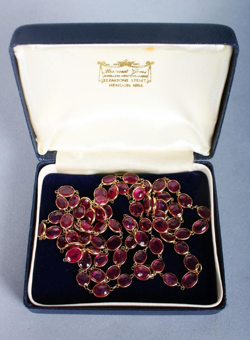 A SUPERB GOLD AND RUBY LONG NECKLACE.