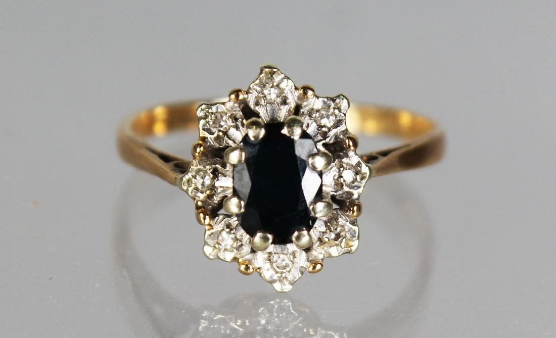 A GOLD CLUSTER DRESS RING
