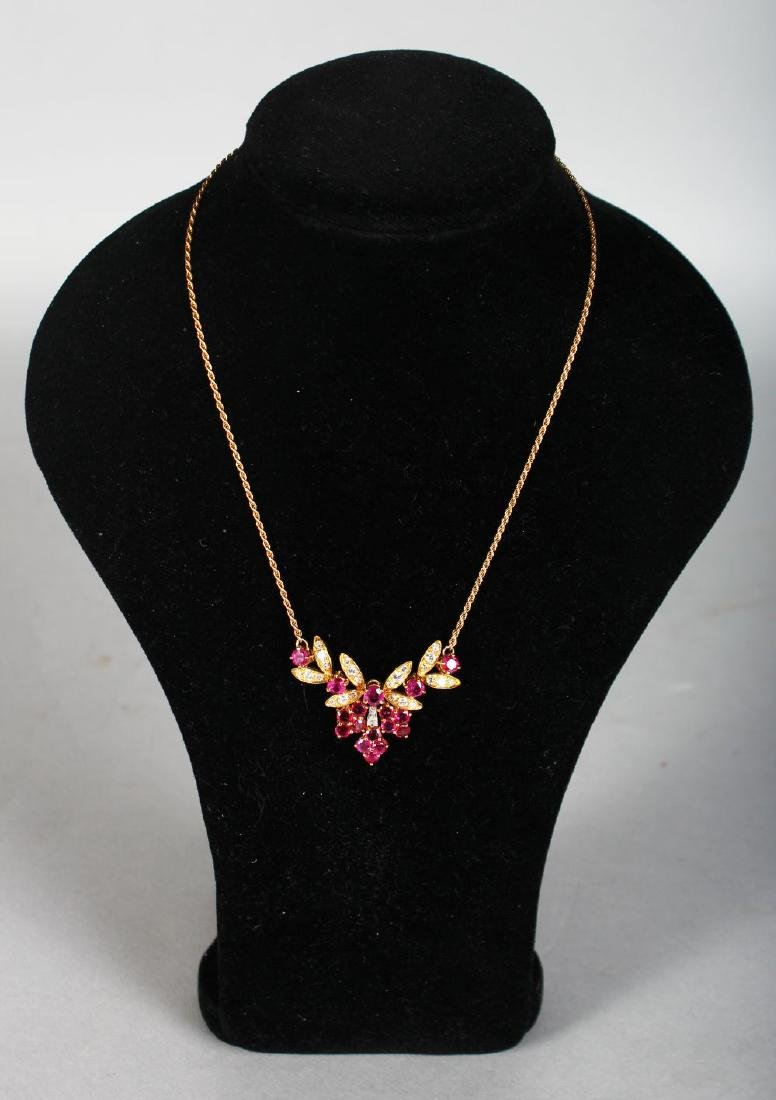 A LOVELY RUBY AND DIAMOND GOLD NECKLACE AND CHAIN.
