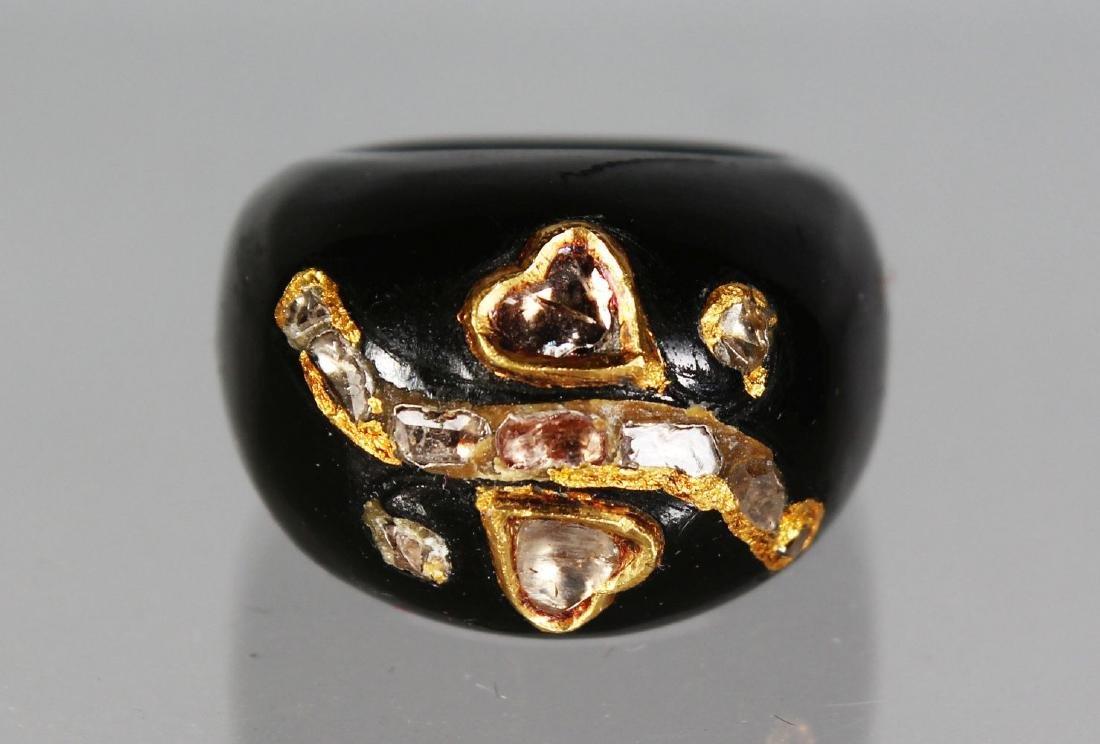 A VICTORIAN JET DIAMOND SET RING.