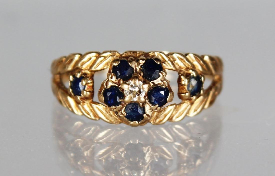 A 9CT GOLD, DIAMOND AND SAPPHIRE RING.