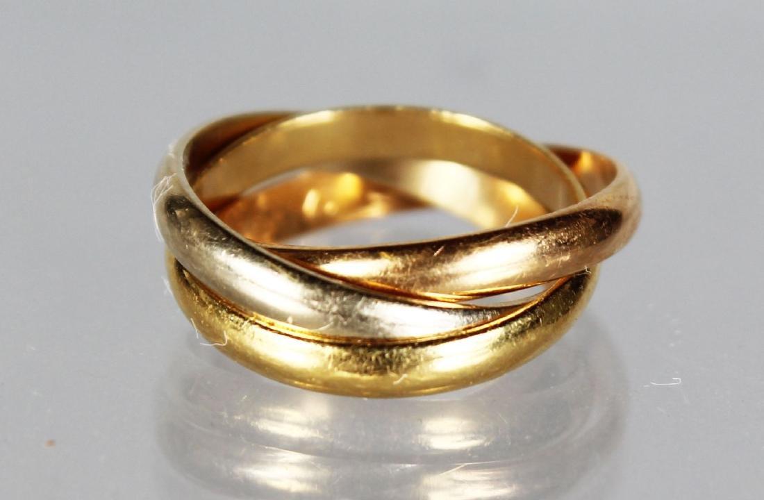 A CARTIER GOLD RING in a Cartier box.