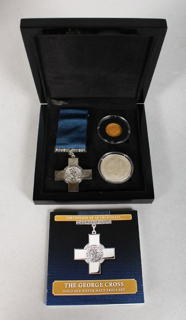 A REPLICA SILVER GEORGE CROSS MEDAL, two crowns, in a