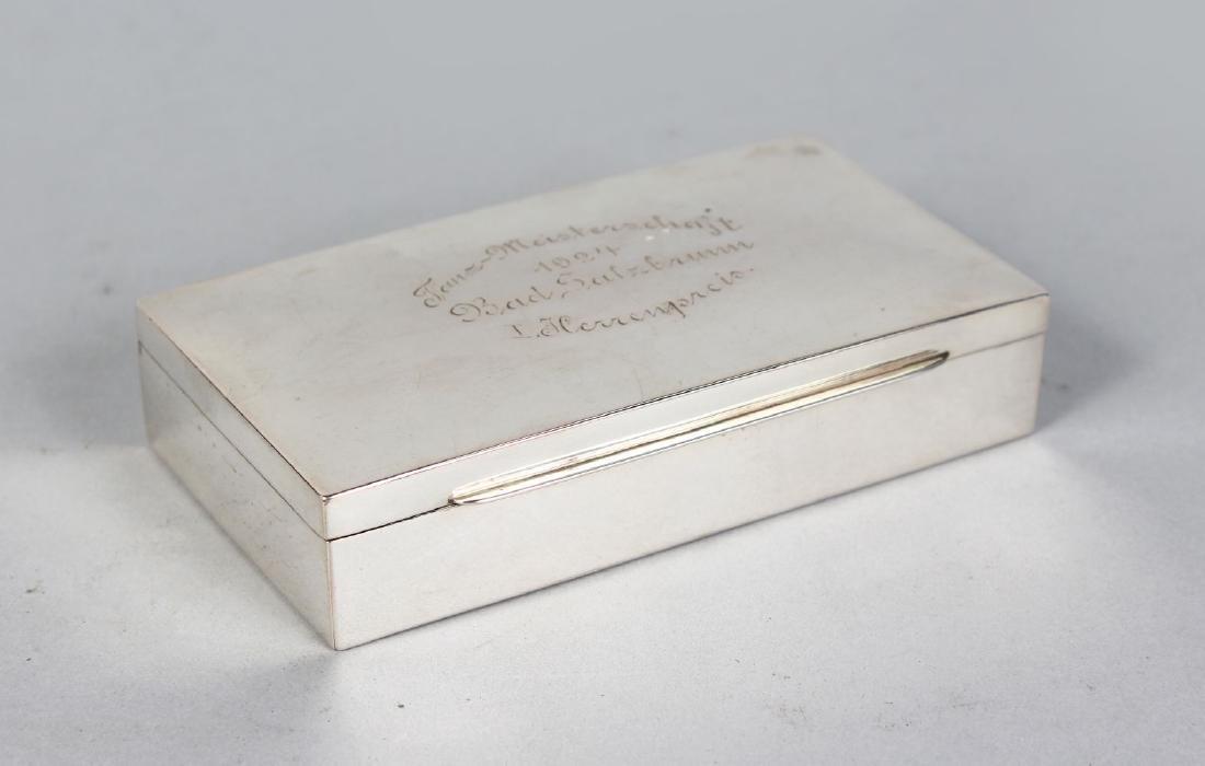 A CIRCULAR .830 CONTINENTAL SILVER CIGARETTE BOX.