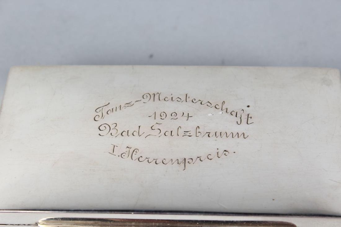 A CIRCULAR .830 CONTINENTAL SILVER CIGARETTE BOX. - 2