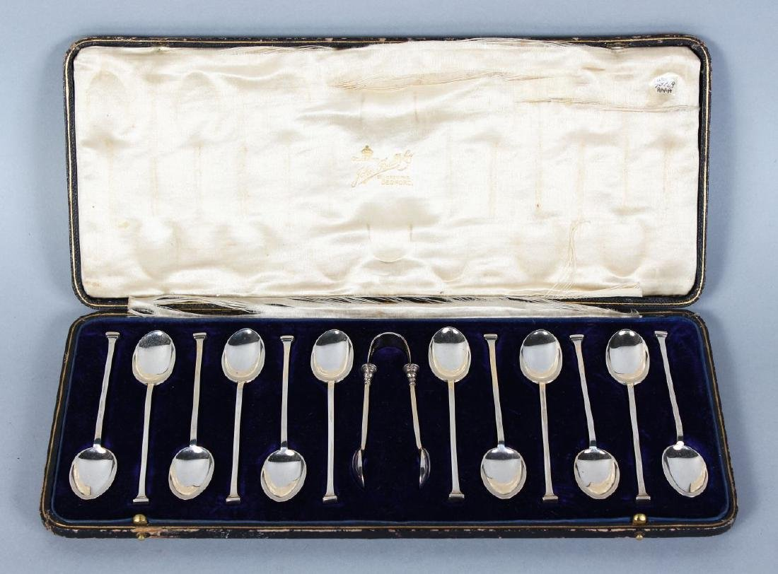 A SET OF TWELVE MAPPIN & WEBB TEASPOONS and SUGAR TONGS