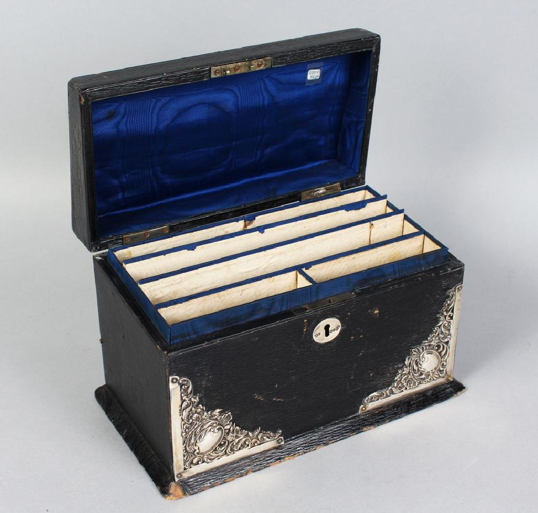 A SILVER MOUNTED LEATHER STATIONERY BOX.  9.5ins wide.