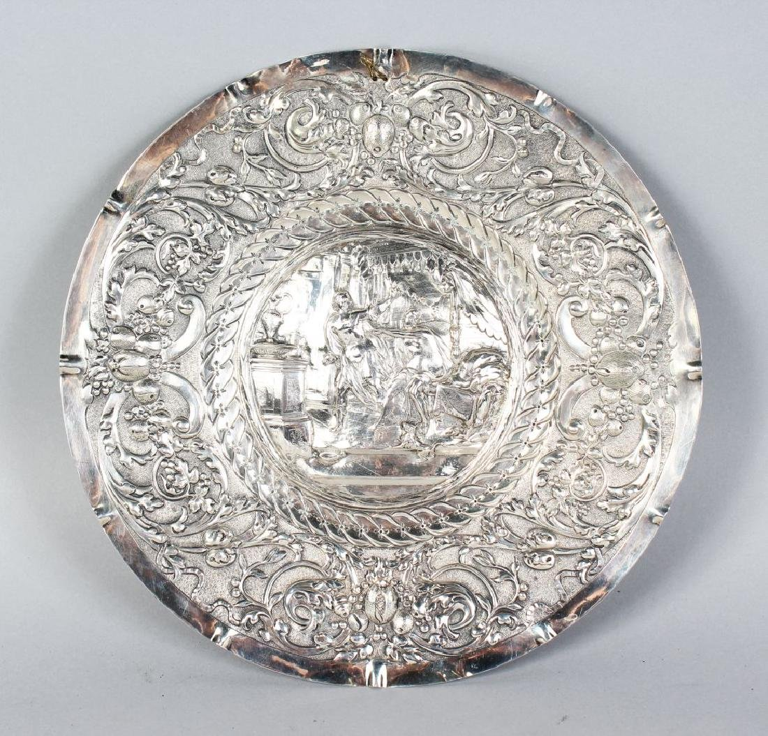 A CONTINENTAL SILVER CIRCULAR DISH with repousse