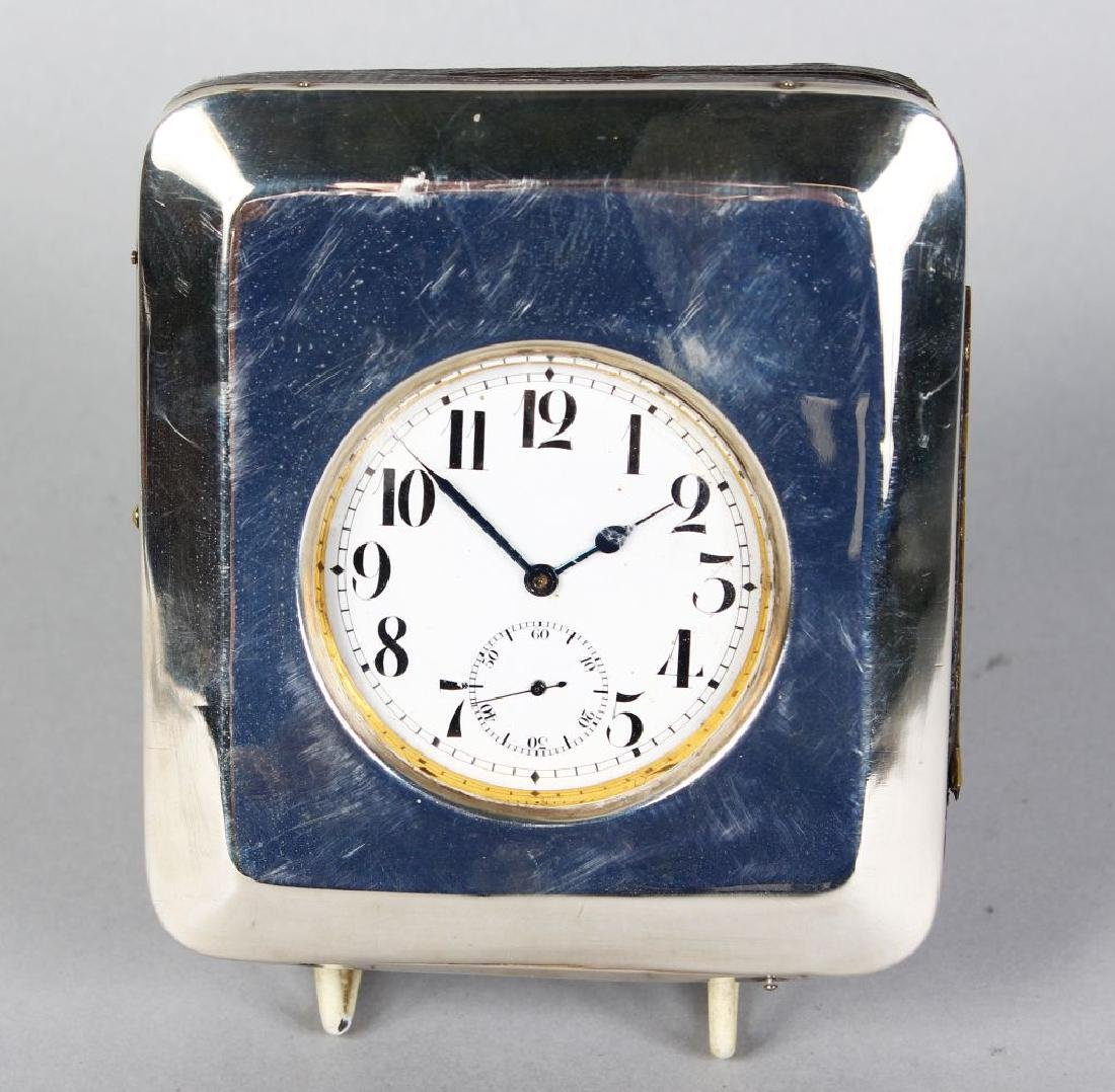 A PLAIN SILVER CASED POCKET WATCH HOLDER AND WATCH.