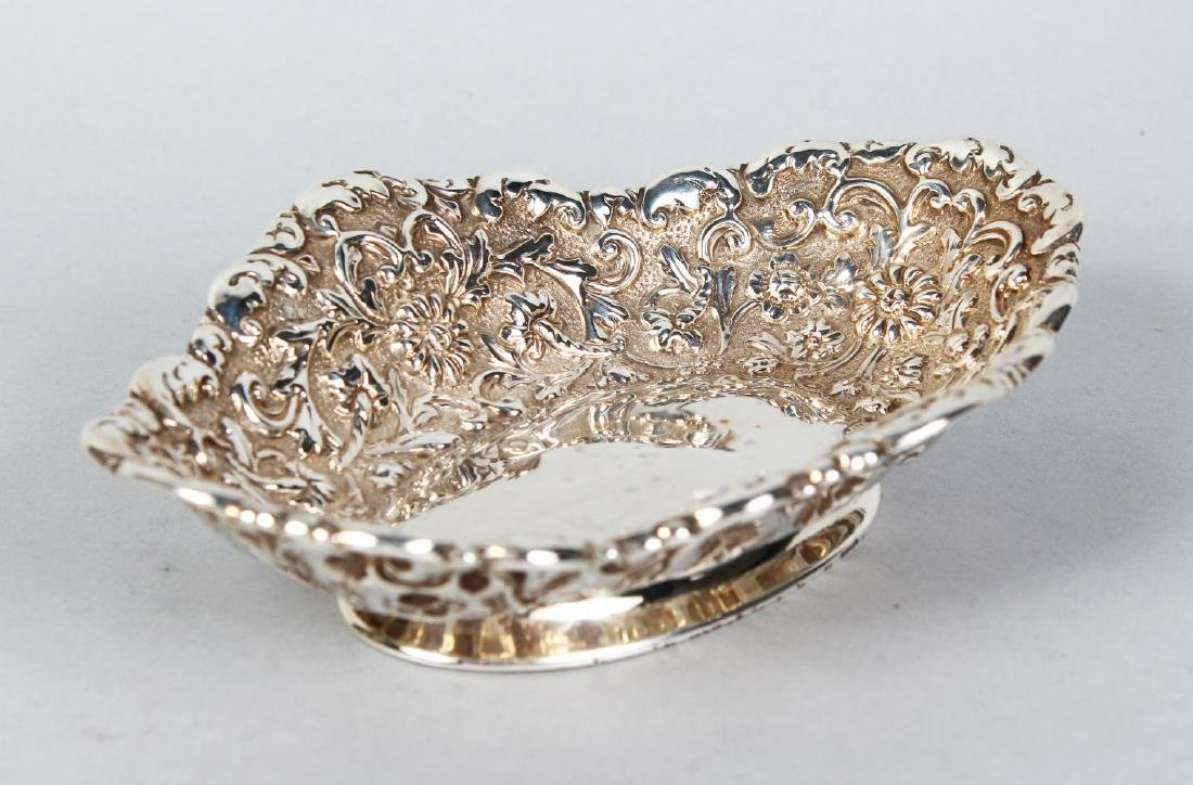 A VICTORIAN OVAL DISH with floral repousse decoration.