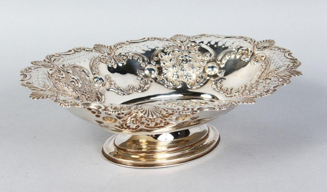 A GOOD PIERCED OVAL CAKE BASKET, pierced with floral