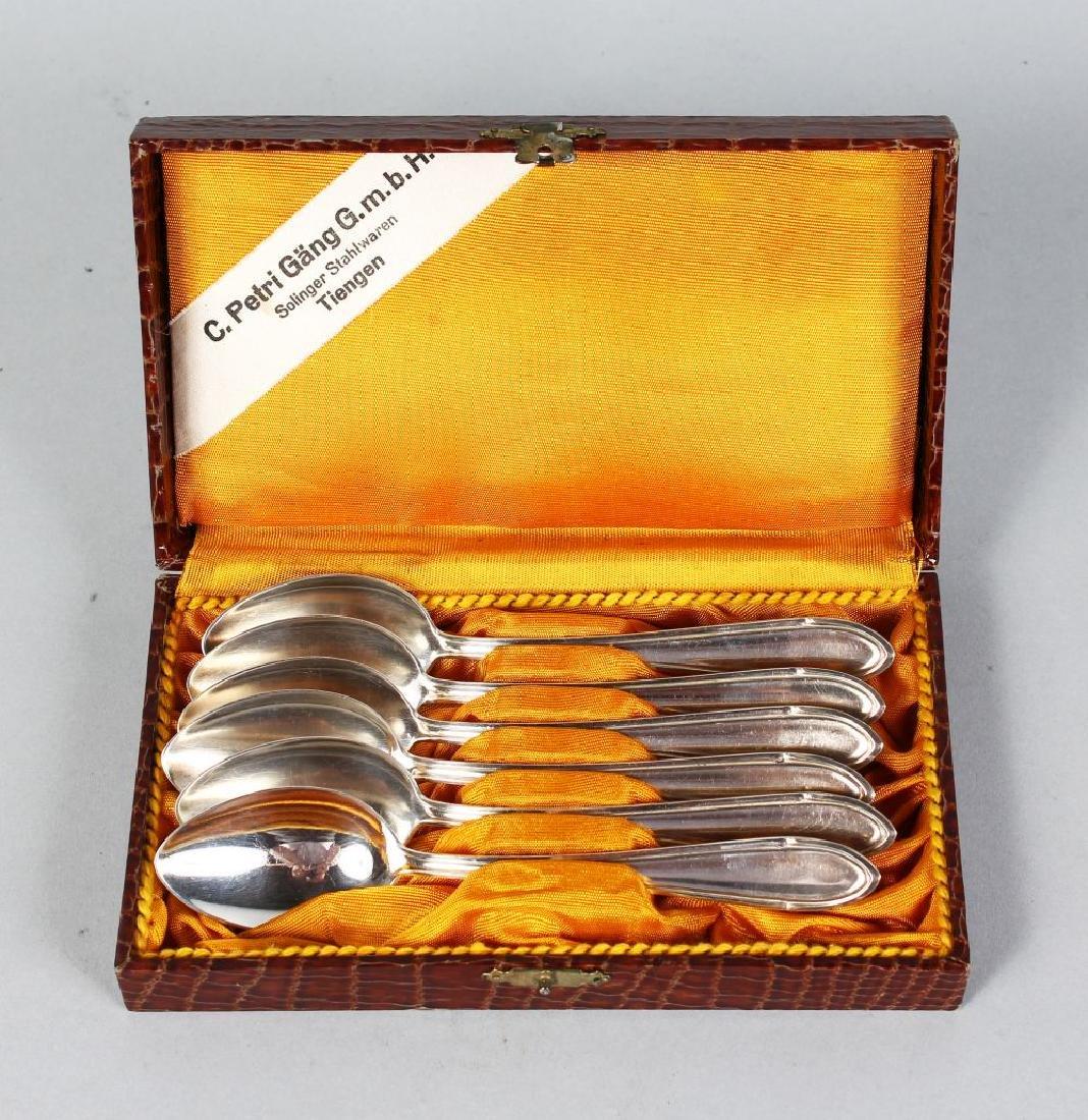 A SET OF SIX BEN-KA TEASPOONS in a leather case.