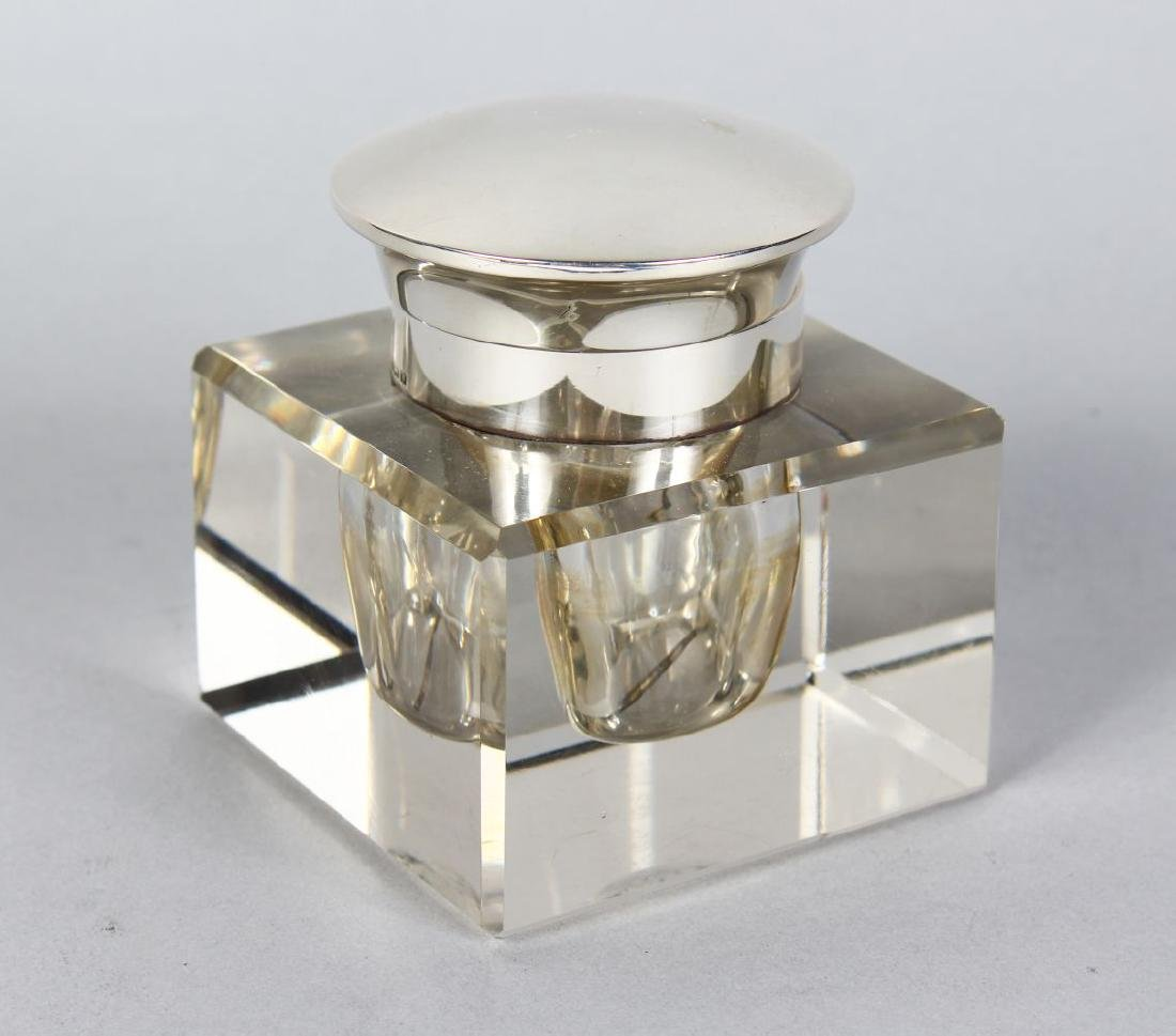 A SQUARE GLASS INKWELL with silver band and top.