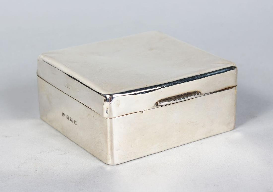 A SQUARE SILVER CIGARETTE BOX with box wood liner.