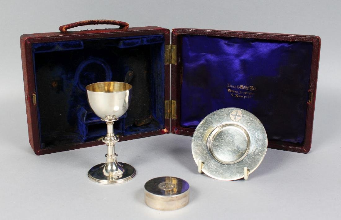 A TRAVELLING SILVER COMMUNION SET, comprising chalice,