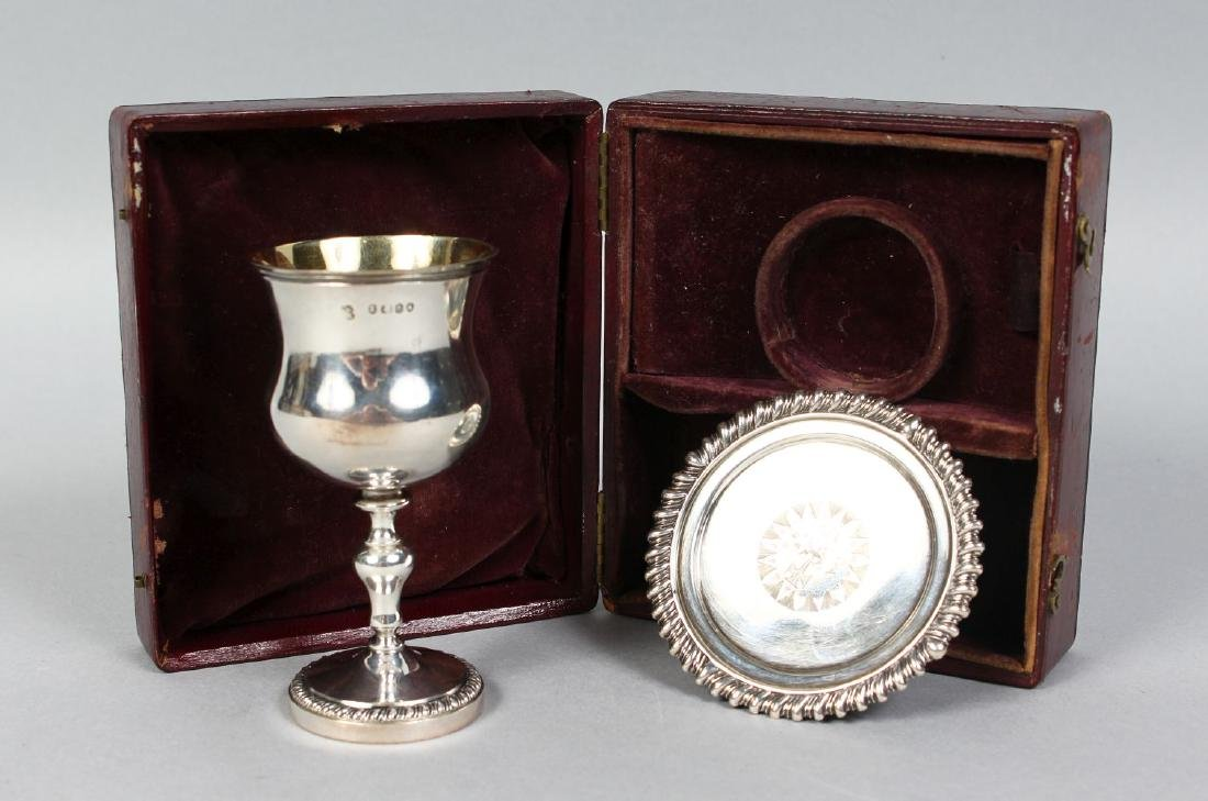 A TRAVELLING SILVER COMMUNION SET, comprising chalice