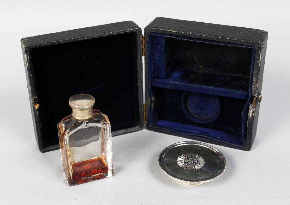 A TRAVELLING SILVER COMMUNION SET, comprising paten and