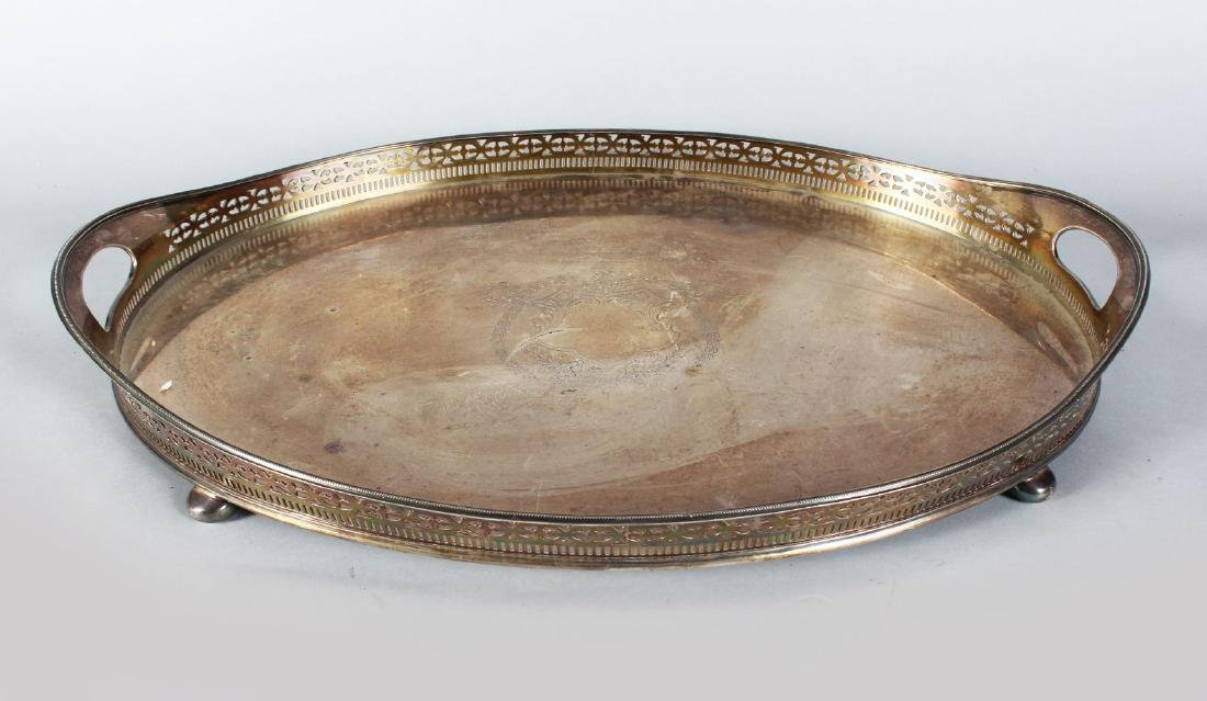 A VERY GOOD OVAL TWO HANDLED TEA TRAY with pierced rim