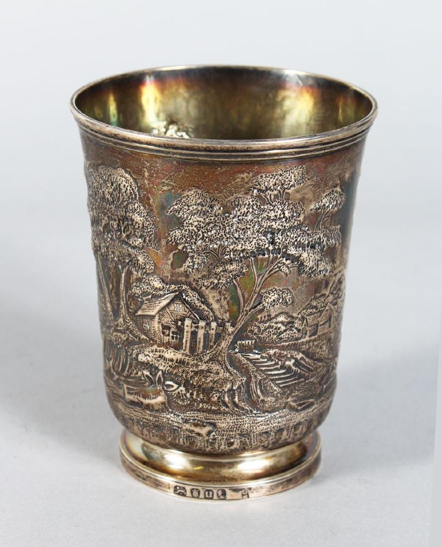 A GEORGE III EMBOSSED BEAKER with later repousse