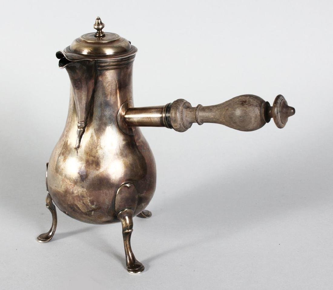 A CONTINENTAL SILVER CHOCOLATE POT with turned wood