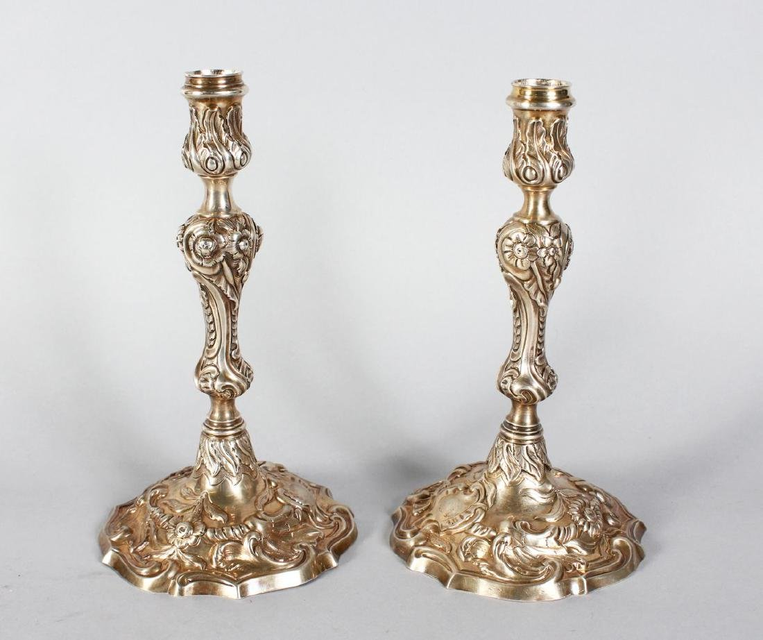 A PAIR OF GEORGE II CAST SILVER CANDLESTICKS  with