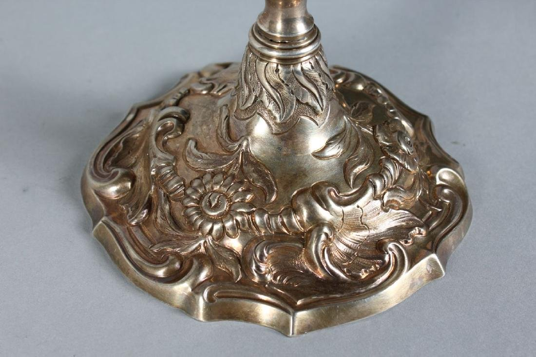 A PAIR OF GEORGE II CAST SILVER CANDLESTICKS  with - 4