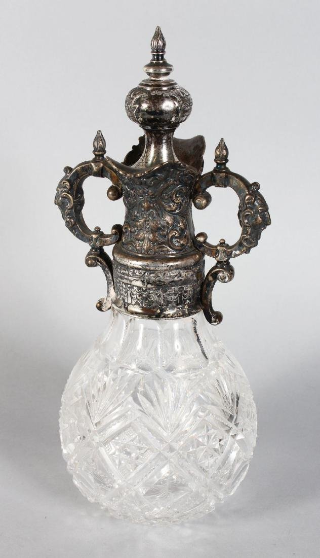 A CONTINENTAL SILVER NOUNTED CUT GLASS TWO HANDLED