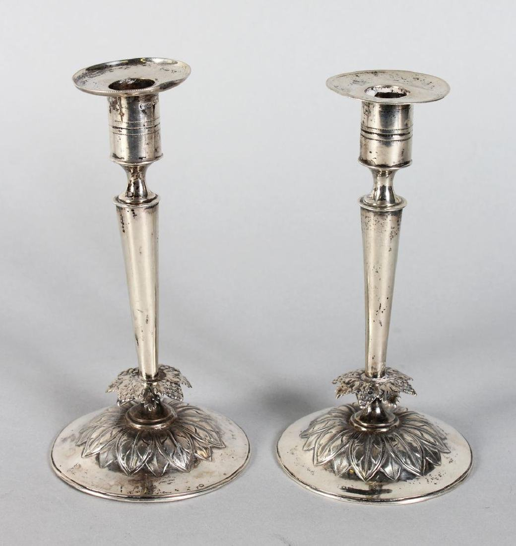 A SMALL PAIR OF CONTINENTAL SILVER CANDLESTICKS.