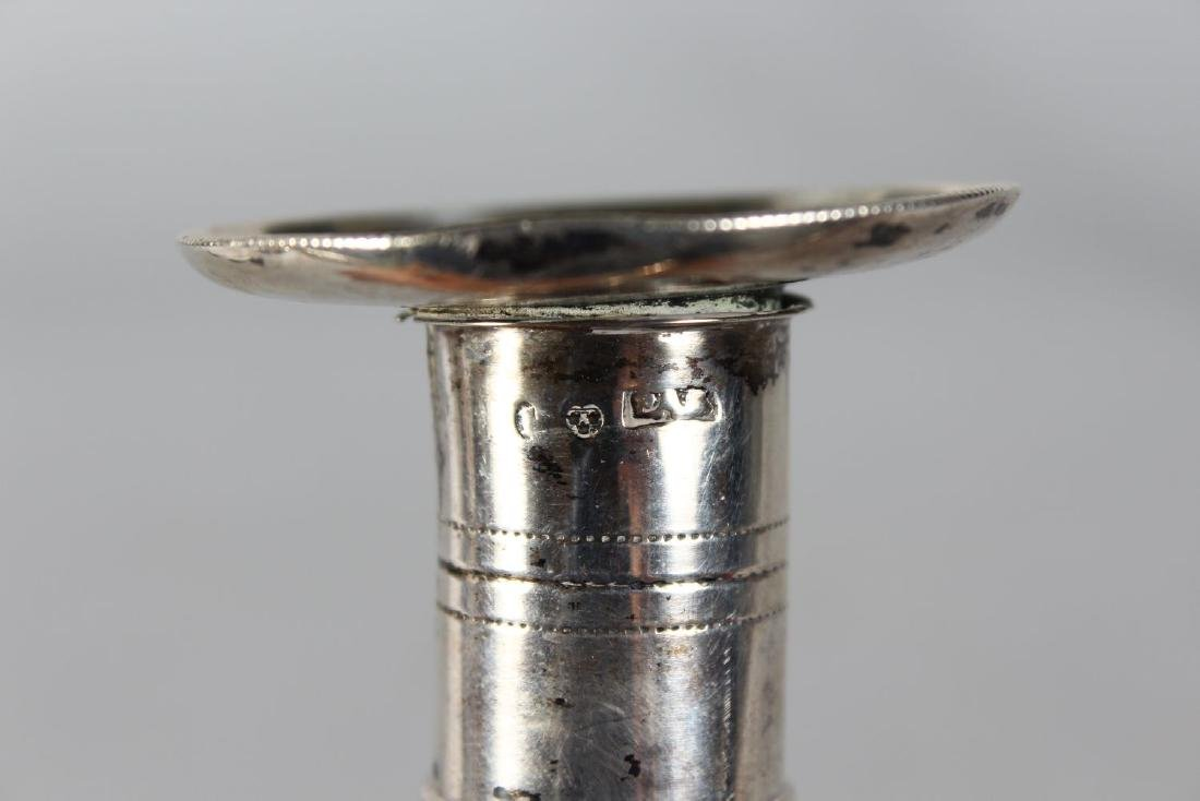 A SMALL PAIR OF CONTINENTAL SILVER CANDLESTICKS. - 2