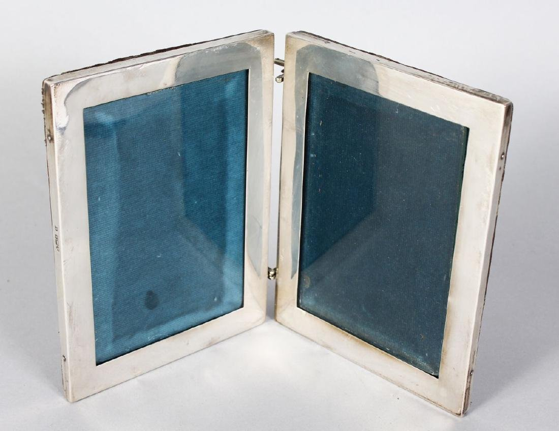 A PLAIN SILVER FOLDING DOUBLE PHOTOGRAPH FRAME,  each
