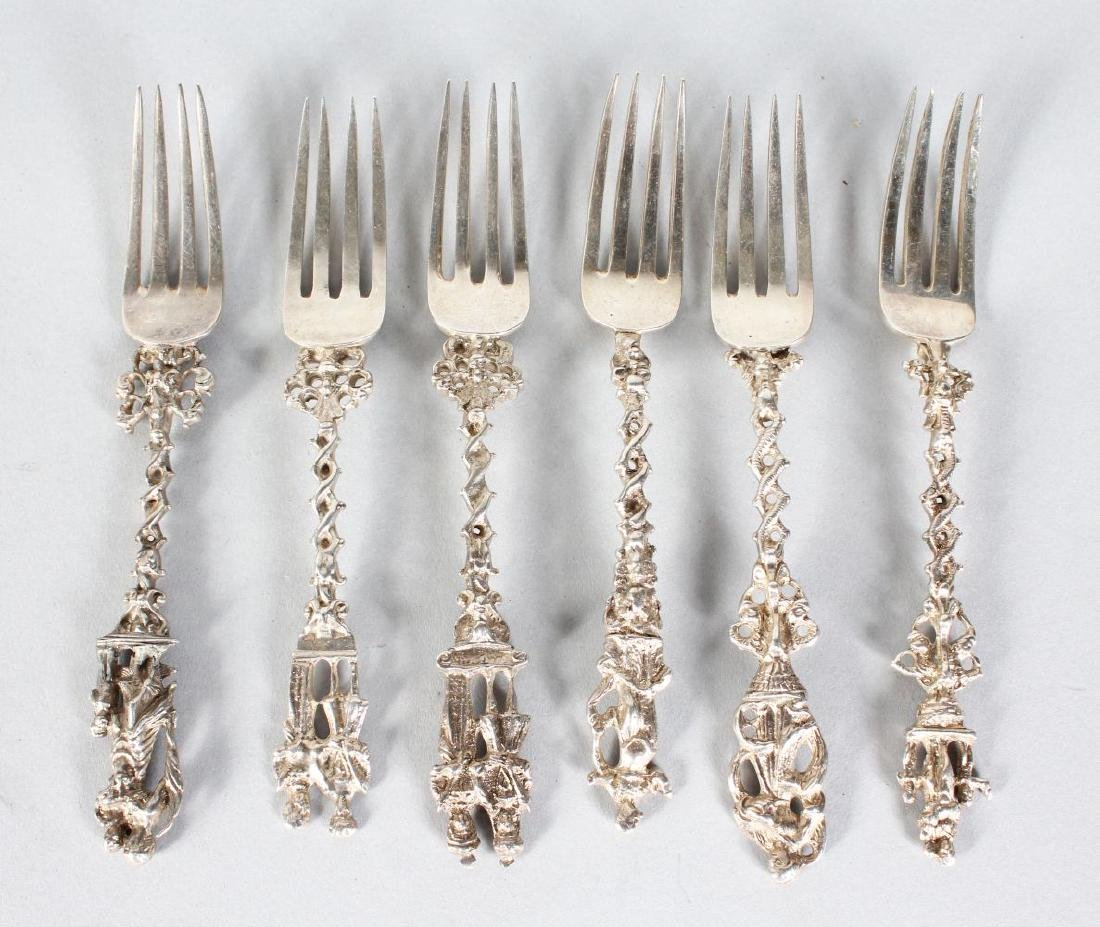 A SET OF SIX CONTINENTAL SILVER APOSTLE FORKS.