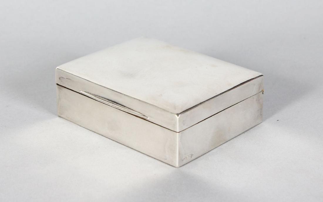A PLAIN CIGARETTE CASE with cedarwood liner.  3.5ins x