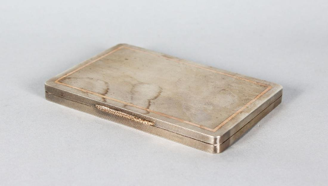AN ENGINE TURNED RECTANGULAR SILVER BOX. 4.5ins x 3ins.