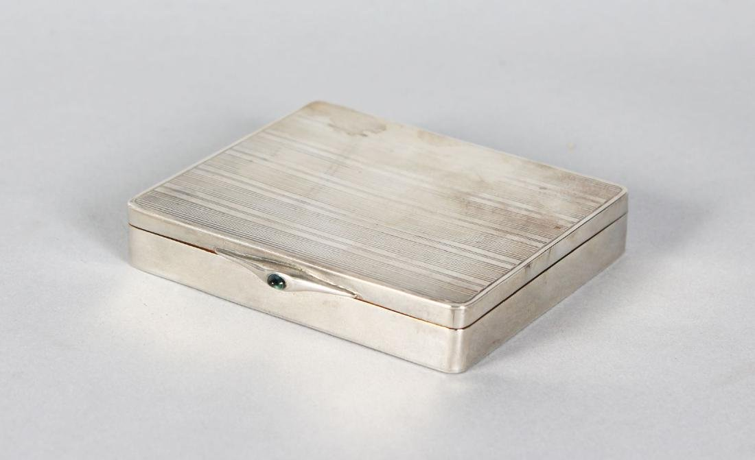 A CONTINENTAL SILVER RIBBED BOX.  3.25ins X 3ins.