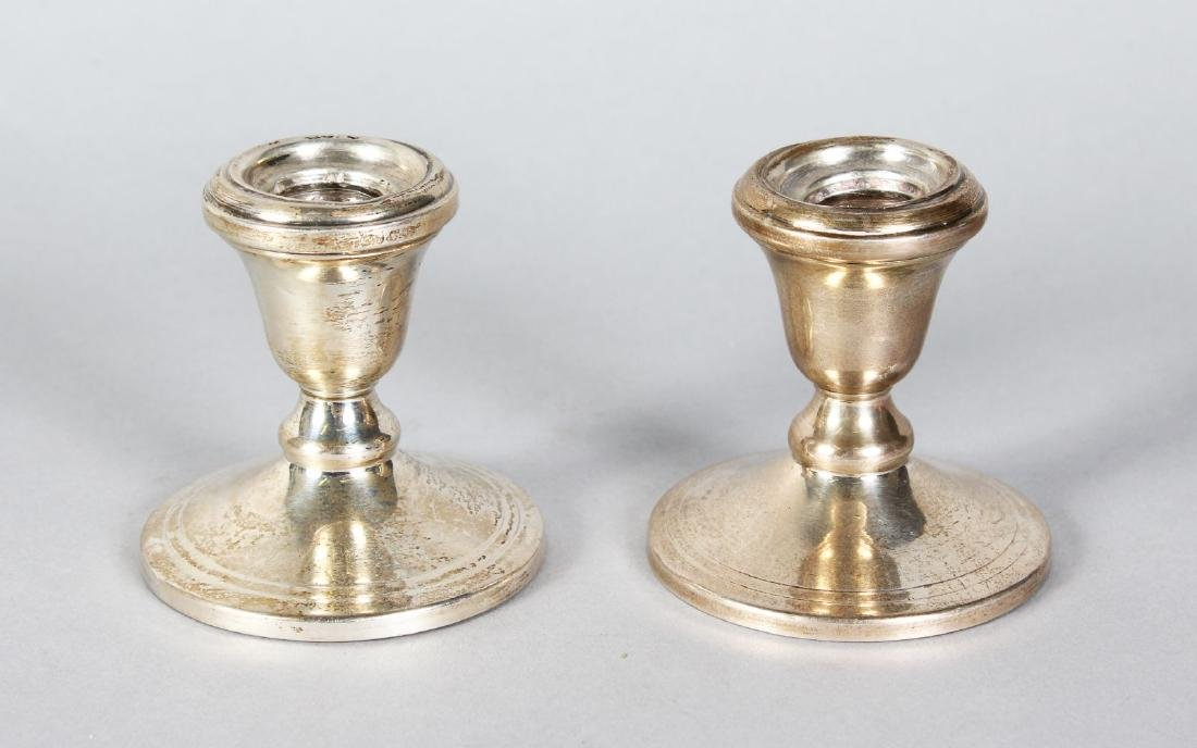 A PAIR OF STERLING SILVER SQUAT CANDLESTICKS with