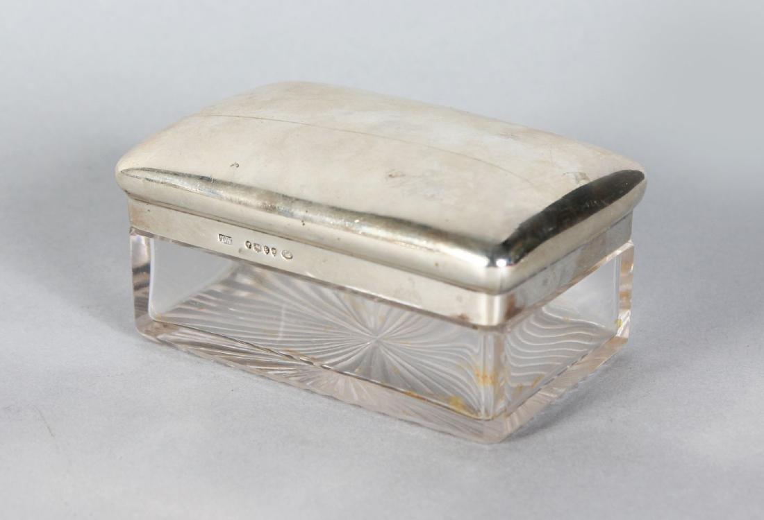 A VICTORIAN SILVER TOPPED GLASS PIN BOX.  London 1880.