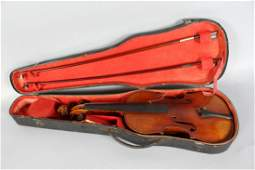 """A CASED VIOLIN AND TWO BOWS, violin bears label """"Copie"""