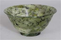 AN EARLY 20TH CENTURY CHINESE JADELIKE HARDSTONE BOWL