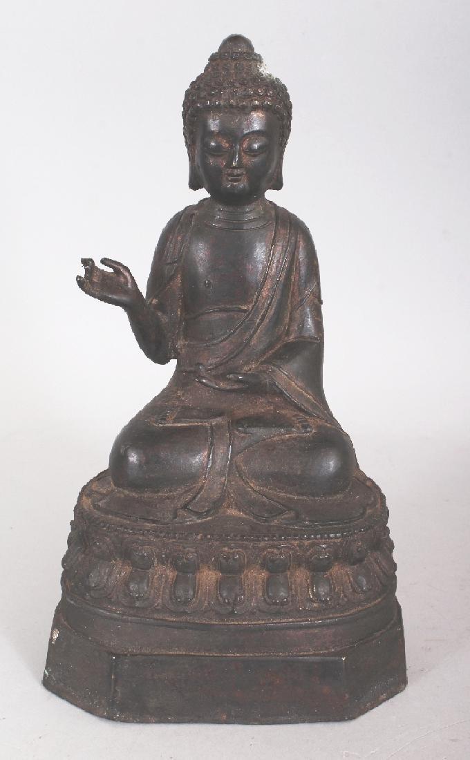 A SINO-TIBETAN BRONZE BUDDHA, seated in dhyanasana on a